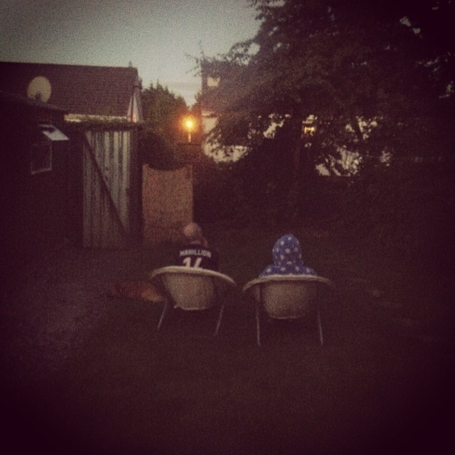 My Parents, sitting in the garden at Dusk.
